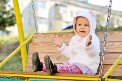 Toddler girl on swing Stock Image