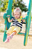 Toddler girl on swing Royalty Free Stock Images