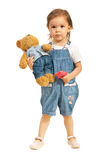 Toddler girl with teddy bear in jeans Stock Photo