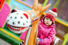 Toddler girl  in theme park Stock Image