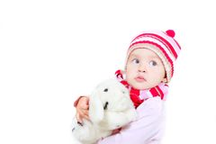 Toddler girl with toy rabbit Stock Photography