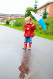 Toddler girl with umbrella Royalty Free Stock Image