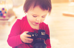 Toddler girl using playing with a camera Stock Image