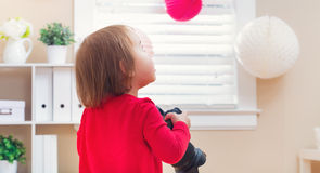 Toddler girl using playing with a camera Stock Photography