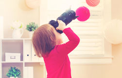 Toddler girl using playing with a camera Royalty Free Stock Images