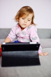 Toddler girl using tablet pc Royalty Free Stock Images