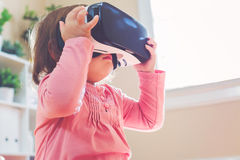 Toddler girl using a virtual reality headset Stock Image