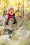 Toddler girl walking at autumn forest Royalty Free Stock Images