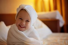 Toddler girl wearing bathrobe after bathing stock photography