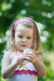 Toddler girl with white Taraxacum officinale or Royalty Free Stock Photos