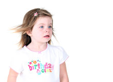 Toddler girl with wind blown hair. Isolated on white background Stock Images