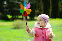 Toddler girl with windmill Royalty Free Stock Images