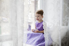 Toddler girl at the window Royalty Free Stock Photo
