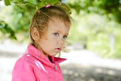 Toddler girl in windy weather Royalty Free Stock Image