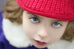 Toddler girl winter hat portrait outdoors Royalty Free Stock Images