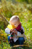 Toddler girl with yellow leaf Royalty Free Stock Photography