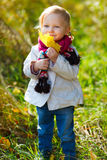 Toddler girl with yellow leave Stock Photo