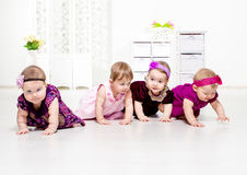 Toddler girls crawling Stock Photo