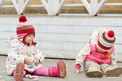 Toddler girls drawing with chalk Royalty Free Stock Photography
