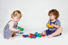 Toddler girls playing with building blocks Stock Photography