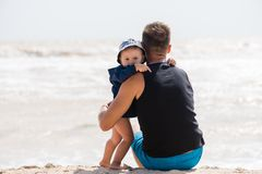 Sweet hug of little boy and father royalty free stock photography