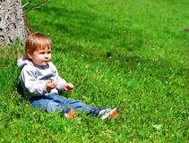 Toddler in grass royalty free stock images