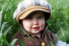 Toddler in the green grass Stock Photo