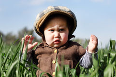 Toddler in the green grass Royalty Free Stock Images