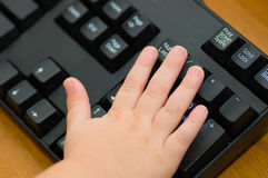 Toddler Hand on Keyboard Royalty Free Stock Image