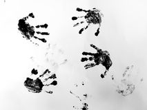 Toddler hand prints. Child hand prints in black paint royalty free stock image