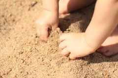 Toddler hands in sand Stock Image