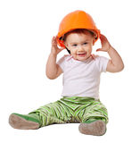 Toddler in hardhat. Plays  over white background Royalty Free Stock Image