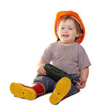 Toddler in hardhat with drill. Isolated over white Stock Images