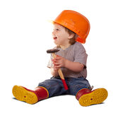Toddler in hardhat with hammer. Isolated over white background  with shade Royalty Free Stock Image