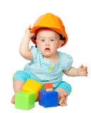 Toddler in hardhat plays  with  blocks Stock Images