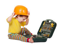 Toddler in hardhat with tool box. Over white background with shade Royalty Free Stock Image