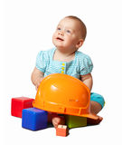 Toddler  with hardhat and toy blocks Stock Photo