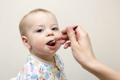Toddler has dinner Stock Photos