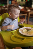 Toddler has a lunch Stock Image