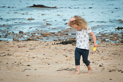 Toddler having fun exploring the beach Royalty Free Stock Image