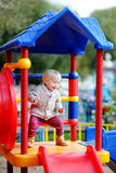 Toddler having fun on playground Royalty Free Stock Photos