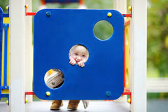 Toddler having fun on playground. Beautiful toddler boy having fun on playground Royalty Free Stock Photos