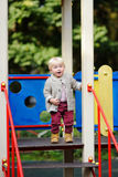 Toddler having fun on playground. Beautiful toddler boy having fun on playground Stock Image