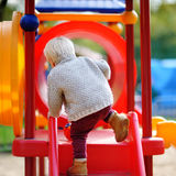 Toddler having fun on playground. Beautiful toddler boy having fun on playground Stock Images