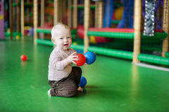 A toddler having fun on a playground Stock Photography