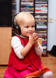 Toddler with headphones Stock Photos