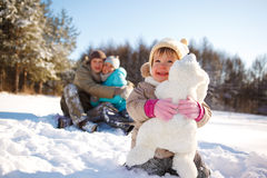 Toddler and her parents Stock Image