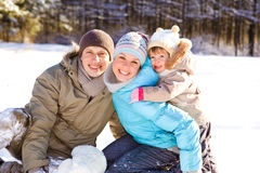 Toddler and her parents in park Stock Photo