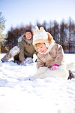 Toddler and her parents in park Stock Image