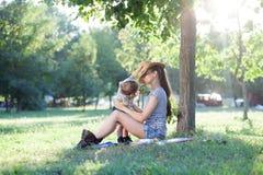 Toddler hiding a mother Stock Photography
